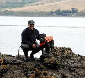 My trusty sidekick, Wilson, helping me do some field work in Tomales Bay. Note the Type-DOG PFD, safety first!